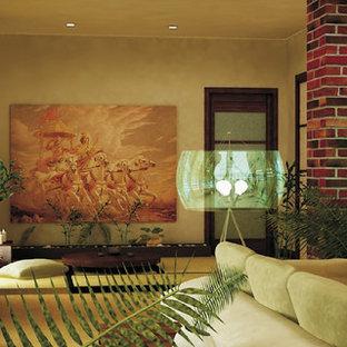 Immagine di un soggiorno tropicale con pareti beige