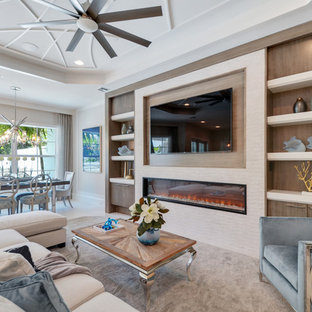 This is an example of a large classic enclosed living room in Miami with white walls, laminate floors, a wall mounted tv, blue floors and a standard fireplace.