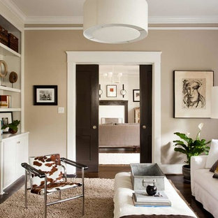 Living room library - mid-sized contemporary enclosed dark wood floor living room library idea in Atlanta with beige walls