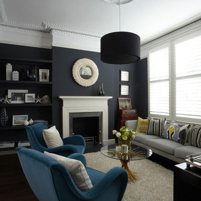 Mid-sized trendy formal living room photo in London with blue walls, a standard fireplace and no tv
