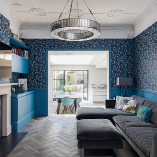 Inspiration for a victorian living room in London with blue walls, dark hardwood flooring, a wall mounted tv and brown floors.
