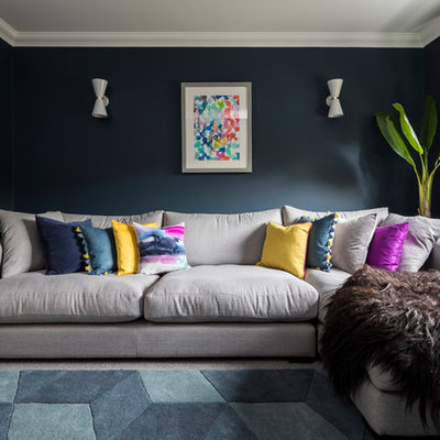 Mid-sized transitional enclosed carpeted and gray floor living room photo in Surrey with blue walls