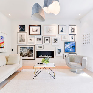 Photo of a large urban living room in London with white walls and a ribbon fireplace.