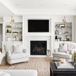 サンフランシスコの中くらいのトランジショナルスタイルのおしゃれなLDK (グレーの壁、無垢フローリング、標準型暖炉、石材の暖炉まわり、茶色い床、壁掛け型テレビ) の写真