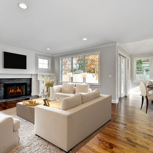 Design ideas for a large arts and crafts formal open concept living room in Chicago with beige walls, carpet, no fireplace, no tv, a stone fireplace surround and beige floor.