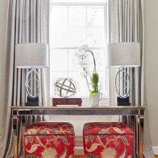 Foto de salón para visitas cerrado, clásico renovado, de tamaño medio, sin televisor, con paredes grises, suelo de madera en tonos medios, chimenea tradicional, marco de chimenea de ladrillo y suelo marrón