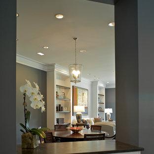 Ispirazione per un grande soggiorno tradizionale aperto con sala formale, pareti grigie, parquet chiaro, camino classico, cornice del camino in pietra e nessuna TV