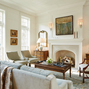 This is an example of a large traditional formal enclosed living room in Chicago with white walls and a standard fireplace.