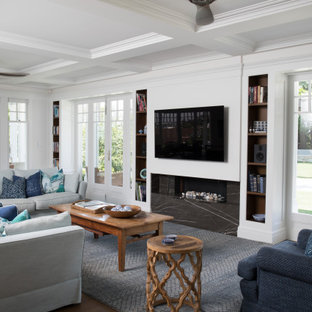 Traditional open concept living room in Brisbane with a stone fireplace surround, a wall-mounted tv, coffered, white walls, medium hardwood floors, a ribbon fireplace and brown floor.