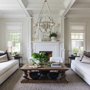 Diseño de salón clásico renovado con paredes beige, suelo de madera oscura, chimenea tradicional, marco de chimenea de ladrillo y suelo marrón