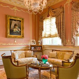 ワシントンD.C.の大きいヴィクトリアン調のおしゃれな独立型リビング (フォーマル、ピンクの壁、無垢フローリング、暖炉なし、テレビなし) の写真