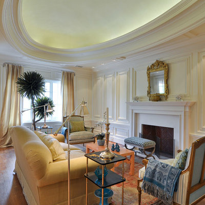 Inspiration for a mid-sized victorian formal and enclosed medium tone wood floor and brown floor living room remodel in Dallas with white walls, a standard fireplace and a tile fireplace