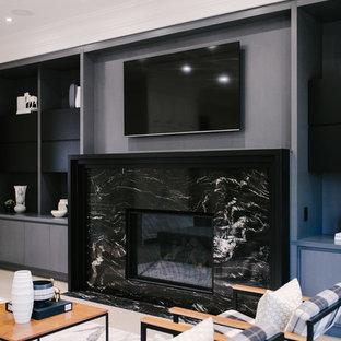 Esempio di un grande soggiorno contemporaneo aperto con pareti grigie, parquet chiaro, camino classico, cornice del camino piastrellata, TV a parete e pavimento beige