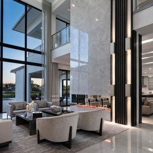 Ispirazione per un soggiorno contemporaneo aperto con pavimento in marmo e camino bifacciale