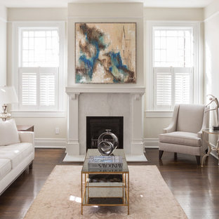 Inspiration for a mid-sized transitional enclosed dark wood floor living room remodel in New Orleans with beige walls and a standard fireplace