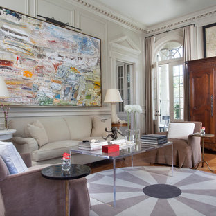 Inspiration for a timeless formal and enclosed medium tone wood floor living room remodel in New Orleans with white walls