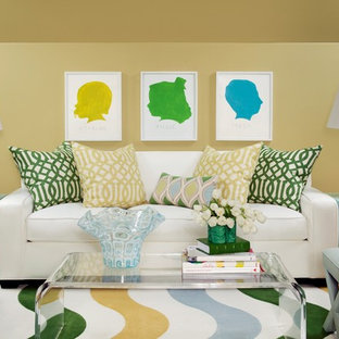 Inspiration for a large timeless open concept medium tone wood floor living room remodel in Little Rock with yellow walls
