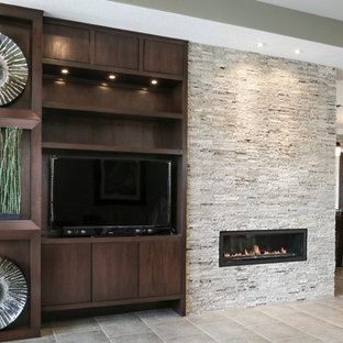 Large minimalist open concept porcelain floor living room photo in Houston with gray walls, a two-sided fireplace, a stone fireplace and a media wall