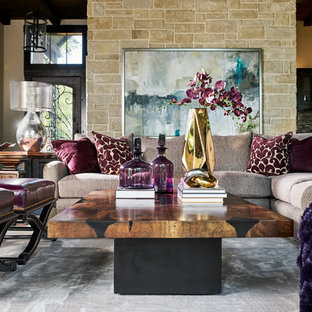 Inspiration for a large timeless open concept dark wood floor and brown floor living room remodel in Other with beige walls, a standard fireplace, a stone fireplace and a wall-mounted tv