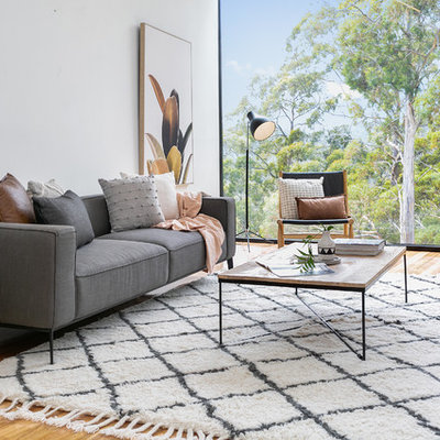 Example of a large trendy open concept medium tone wood floor and brown floor living room design in Hobart with white walls