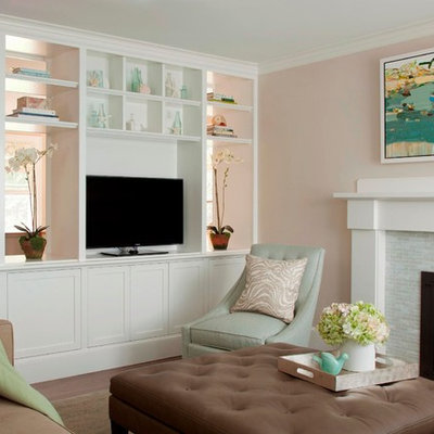 Example of a large beach style open concept medium tone wood floor living room design in Boston with pink walls, a standard fireplace, a tile fireplace and a media wall