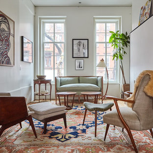 Eclectic formal medium tone wood floor living room photo in New York with white walls, no fireplace and no tv