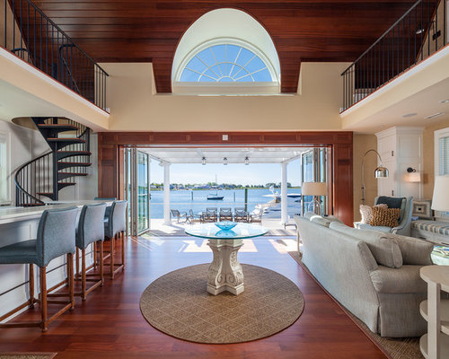 Example Of A Coastal Open Concept Medium Tone Wood Floor Living Room Design  In Other Part 89