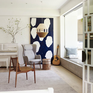Photo of a contemporary living room in Sydney with white walls, light hardwood floors, no fireplace and no tv.