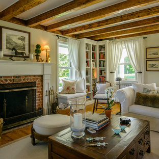 Example of a farmhouse formal medium tone wood floor living room design in Montreal with a standard fireplace and a brick fireplace