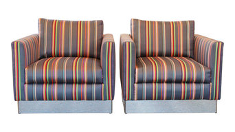 Club chairs reupholstered in Paul Smith fabric