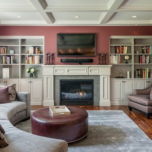 Example of a classic formal and enclosed medium tone wood floor living room design in Seattle with a standard fireplace, a tile fireplace, a wall-mounted tv and red walls
