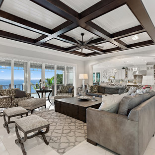 Example of a beach style white floor living room design in Tampa with gray walls