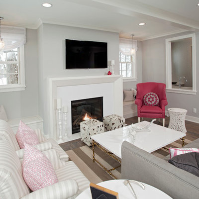 Living room - mid-sized coastal enclosed living room idea in Minneapolis with gray walls, a standard fireplace and a wall-mounted tv