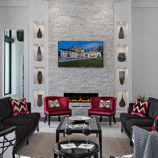 マイアミのコンテンポラリースタイルのおしゃれなリビング (白い壁、濃色無垢フローリング、石材の暖炉まわり、フォーマル、横長型暖炉) の写真