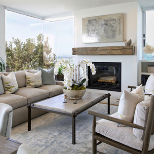 Example of a mid-sized transitional formal and open concept dark wood floor and brown floor living room design in Santa Barbara with white walls, a standard fireplace, a plaster fireplace and no tv
