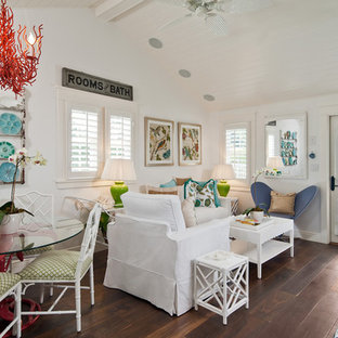 Inspiration for a tropical dark wood floor living room remodel in Miami with white walls