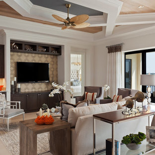 Example of a classic open concept living room design in Miami with a bar, white walls and a wall-mounted tv
