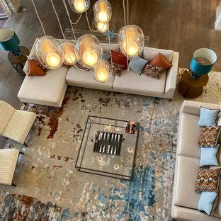 Large coastal mezzanine living room in Other with grey walls and dark hardwood flooring.