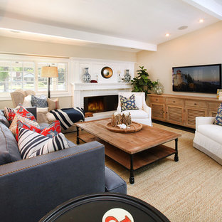 Inspiration for a large beach style living room remodel in Orange County with beige walls, a standard fireplace and a brick fireplace