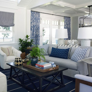Example of a coastal open concept living room design in San Diego