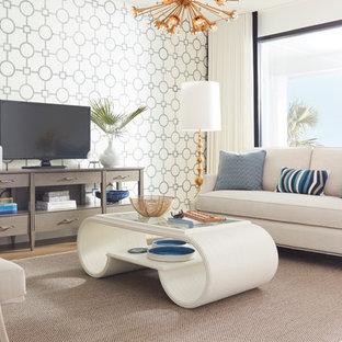 オレンジカウンティの中くらいのビーチスタイルのおしゃれな独立型リビング (フォーマル、白い壁、淡色無垢フローリング、暖炉なし、据え置き型テレビ、茶色い床) の写真