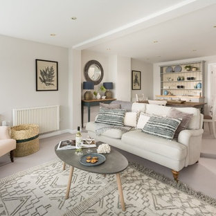Design ideas for a medium sized beach style open plan living room in Cornwall with beige walls, carpet and grey floors.