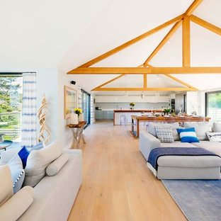 This is an example of a beach style living room in Cornwall.