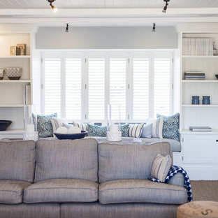 Photo of a large beach style enclosed living room in Sussex with grey walls and carpet.