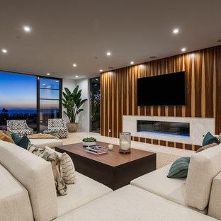 Ejemplo de salón para visitas abierto, contemporáneo, grande, con paredes marrones, chimenea lineal, marco de chimenea de piedra, televisor colgado en la pared, suelo beige y suelo de mármol