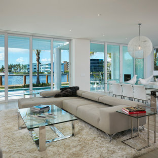 Inspiration for a large modern formal and open concept light wood floor living room remodel in Miami with beige walls, no fireplace and a wall-mounted tv