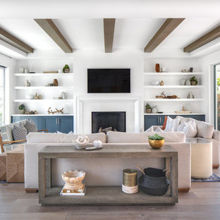 Living room - large modern open concept medium tone wood floor and brown floor living room idea in Orange County with white walls, a standard fireplace, a tile fireplace and a wall-mounted tv