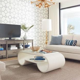 ウィルミントンの中サイズのビーチスタイルのおしゃれな独立型リビング (フォーマル、白い壁、無垢フローリング、暖炉なし、据え置き型テレビ、茶色い床) の写真