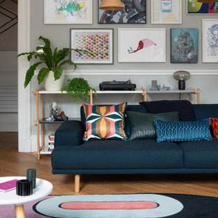Design ideas for a large contemporary living room in Edinburgh with grey walls, medium hardwood flooring and no tv.