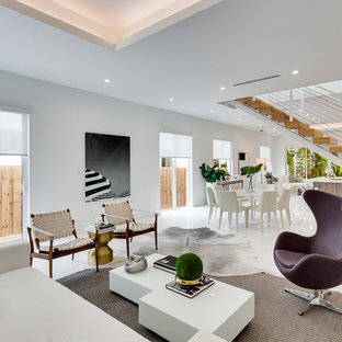 Living room - large contemporary open concept white floor and ceramic floor living room idea in Miami with white walls and no tv